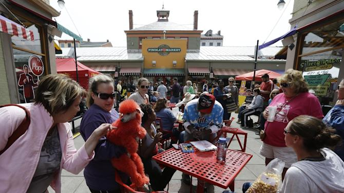 This April 14, 2013 photo shows a dyed red poodle at Findlay Market in Cincinnati. Cincinnati residents have been getting fresh meat, produce and homemade bread at Findlay Market since 1855, making it the oldest continuously running public market in the Buckeye State, (AP Photo/Al Behrman)