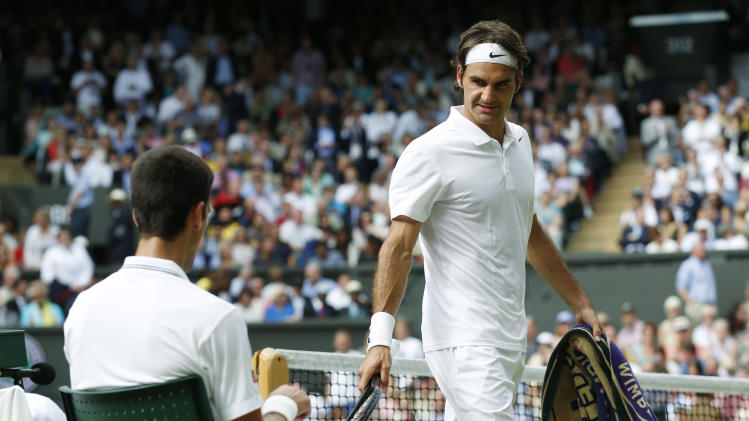 in Wimbledon, London, Sunday, July 6, 2014. (AP Photo/Sang Tan, Pool