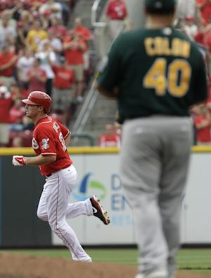 Bruce powers Reds past Athletics 6-5