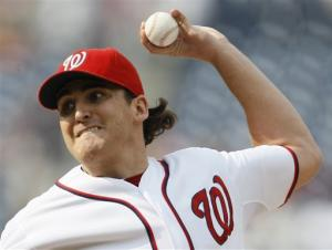 Johnson outpitches Gonzalez; Miami and Nats split