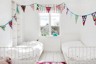 A super cute room and a fun ladder on the left.