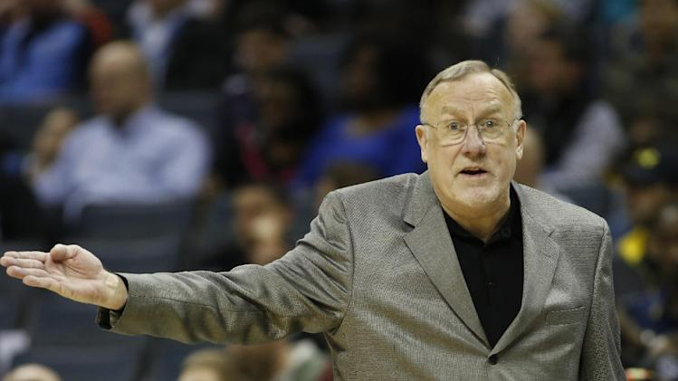 Minnesota Timberwolves coach Rick Adelman argues a call as his team plays the Charlotte Bobcats during the first half of an NBA basketball game in Charlotte, N.C., Friday, March 14, 2014. Charlotte won 105-93. (AP Photo/Nell Redmond)