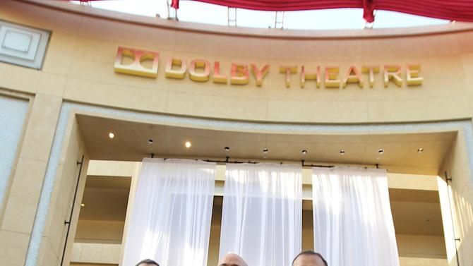 COMMERCIAL IMAGE - In this image provided by Dolby Laboratories, from left, Tom Sherak, president of Academy of Motion Picture Arts and Sciences, Kevin Yeaman, president and CEO of Dolby Laboratories and Ramzi Haidamus, EVP, sales and marketing, Dolby Laboratories, unveil the new Dolby Theatre on Monday June 11, 2012 in Los Angeles. (Photo by Matt Sayles/Invision for Dolby)