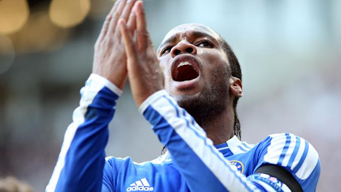 Chelsea's Didier Drogba celebrates his goal during their English Premier League soccer match against Newcastle United at the Sports Direct Arena, Newcastle, England, Saturday, Dec. 3, 2011. (AP Photo/Scott Heppell)