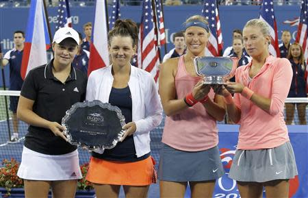 Hlavackova and Hradecka of the Czech Republic pose with their trophy along with Barty and Dellacqua of Australia after their women's doubles final match at the U.S. Open tennis championships in New York