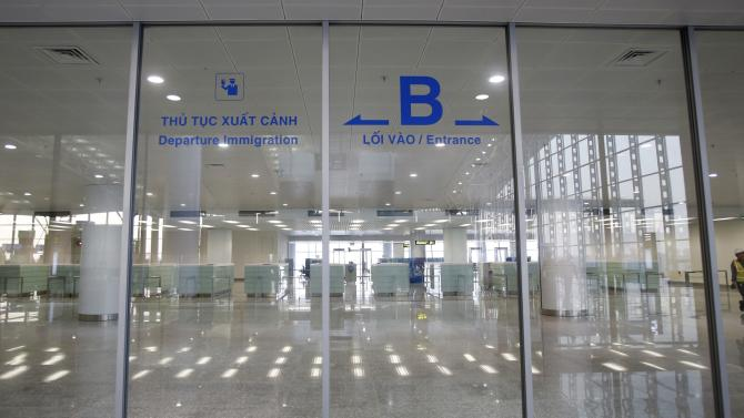 A worker leaves the immigration hall of the new terminal two wing at Noi Bai international airport in Hanoi