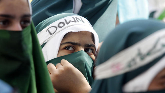 """Kashmiri Muslim students participate in a protest rally against an anti-Islam film called """"Innocence of Muslims"""" that ridicules Islam's Prophet Muhammad, in Srinagar, India, Saturday, Sept. 22, 2012. (AP Photo/Mukhtar Khan)"""