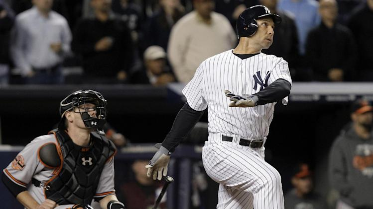 New York Yankees' Raul Ibanez follows through on a home run as Baltimore Orioles catcher Matt Wieters watches during the ninth inning of Game 3 of the American League division baseball series Wednesday, Oct. 10, 2012, in New York. (AP Photo/Kathy Willens)