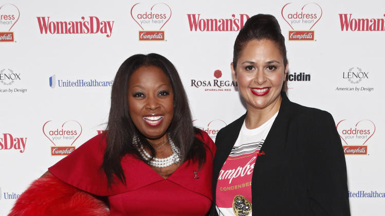 """IMAGE DISTRIBUTED FOR CAMPBELL SOUP COMPANY - Television personality Star Jones, left, and fan favorite and finalist on Bravo's """"Top Chef All-Stars,"""" Chef Antonia Lofaso walk the red carpet at the Woman's Day Red Dress Awards on Tuesday, Feb. 12, 2013, in New York City. The event was in support of the American Heart Association's Go Red for Women movement. For more information, visit AddressYourHeart.com. (Brian Ach/AP Images for Campbell Soup Company)"""