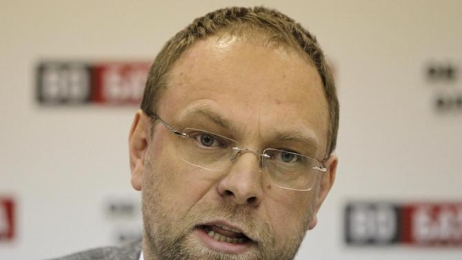 Serhiy Vlasenko, lawyer of former Prime Minister Yulia Tymoshenko answers media questions  in Kiev, Ukraine, Monday, Jan. 21, 2013.  Vlasenko expressed his outrage against criminal cases filed against him and what he suspects are government plans for his arrest.(AP Photo/Sergei Chuzavkov)