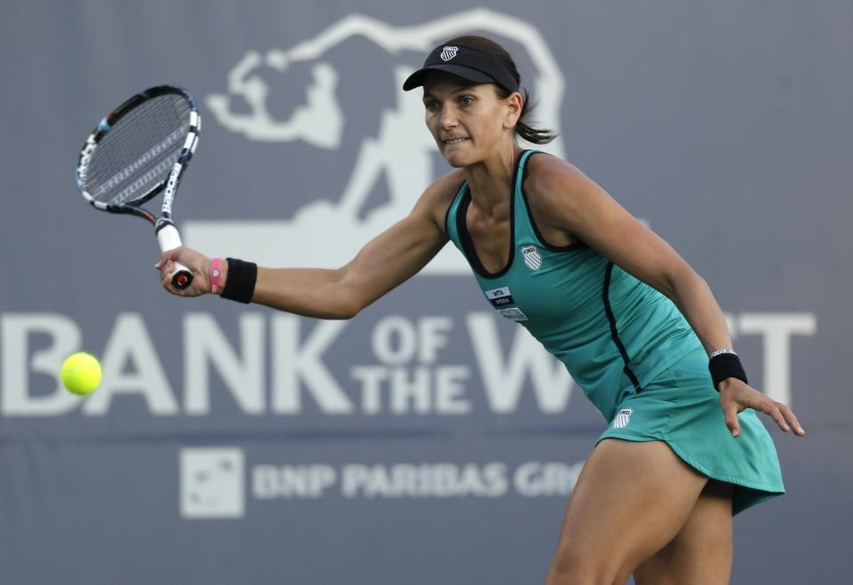 Chanelle Scheepers, of South Africa, returns to Serena Williams, of the United States, during a quarterfinal of the Bank of the West tennis tournament Friday, July 13, 2012, in Stanford, Calif. (AP Photo/Marcio Jose Sanchez)