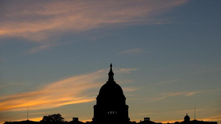 FILE - In this Sept. 15, 2013, file photo, the U.S. Capitol dome is silhouetted by the sunrise. Doctors who treat Medicare patients would get a last-minute reprieve from a scheduled 24 percent cut in their reimbursements from the government under a bill that's on track to pass the House. It would be the 17th time Congress has stepped in with a temporary fix to a poorly designed Medicare fee formula that dates to a 1997 budget law. House action comes after efforts to permanently fix the formula appear to have fizzled. (AP Photo/Carolyn Kaster, File)