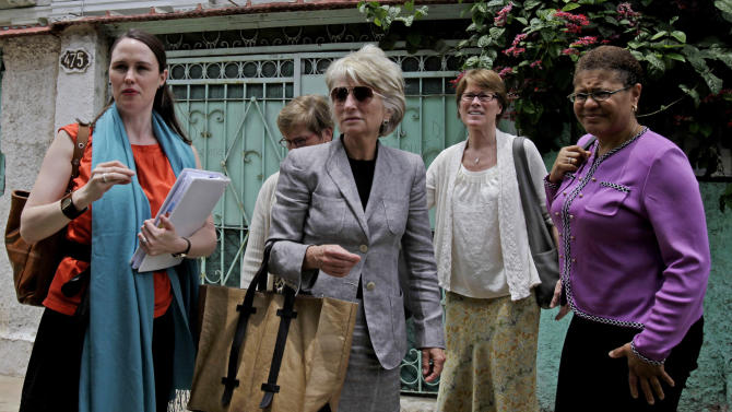 A U.S. women's delegation including Tatman Ryder Savio, a Washington, D.C. lawyer, from left, former democratic Rep. Jane Harman, wearing sunglasses, and Sarah Stephens, director of the Center for Democracy arrive at the Cuban National Center for Sex Education in Havana, Cuba, Monday, June 6, 2011. A group of U.S. women leaders met with Cuba's President Raul Castro's daughter's, Mariela Castro, for an exchange of ideas on topics including gender, reproductive health and gay rights. The trip was organized by the Center for Democracy in the Americas, which studies U.S. policy toward countries in the region. Woman on right is unidentified. (AP Photo/Javier Galeano)