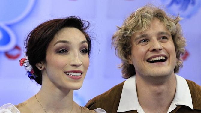 REMOVES REFERENCE TO WINNING - Meryl Davis and Charlie White smile after their senior pairs short dance program at the U.S. Figure Skating Championships in Omaha, Neb., Friday, Jan. 25, 2013. (AP Photo/Nati Harnik)
