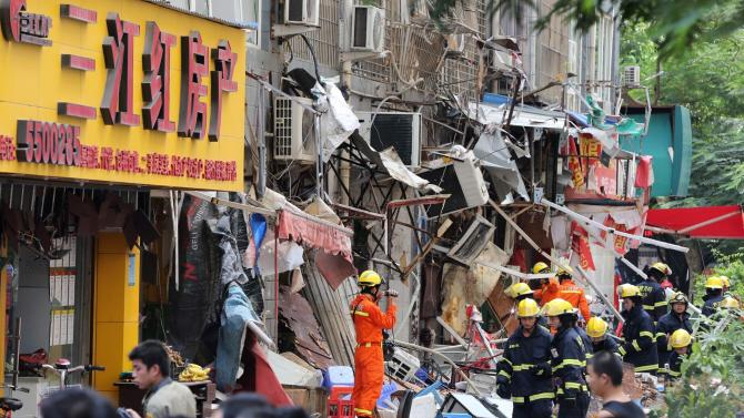 Firefighters work at the site of an explosion in Xiamen