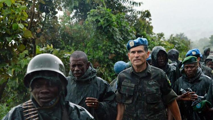 DR Congo Army General Bahuma Ambamba (2nd L) walks with UN mission in DR Congo (MONUSCO) General Carlos Alberto Dos Santos of Brazil on November 5, 2013 near Chanzu, in the eastern North Kivu region