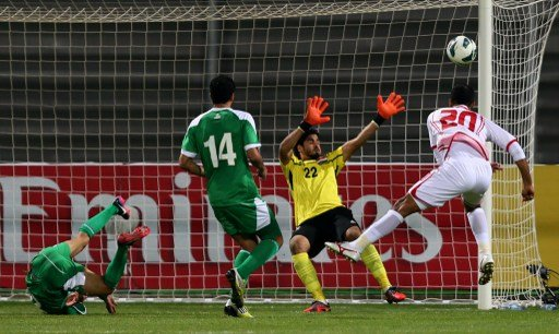 Ali Salem (R) of UAE head the ball in front of Iraq's goalkeeper during the 21st Gulf Cup's final between United Arab Emirates (UAE) and Iraq on January 18, 2013 in Manama. United Arab Emirates won 2-