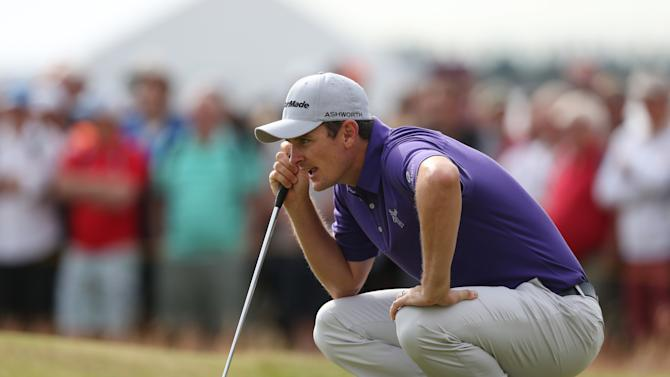Justin Rose of England lines up a putt on the 1st green during the second day of the British Open Golf championship at the Royal Liverpool golf club, Hoylake, England, Friday July 18, 2014. (AP Photo/Jon Super)