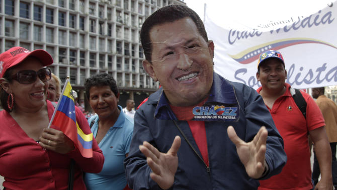 "A man wearing a handcrafted mask depicting the face of Venezuela's President Hugo Chavez attends an event commemorating the violent street protests of 1989 known as the ""Caracazo,"" in Caracas, Venezuela, Wednesday, Feb. 27, 2013. The wave of the 1989 violent protests, seen by the Chavez government as a ""popular uprising,"" was in response to the economic measures imposed by then President Carlos Andres Perez. (AP Photo/Ariana Cubillos)"