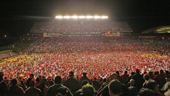 FILE - This Nov. 9, 2006 file photo shows fans on the field after Rutgers defeated Louisville 28-25 in a college football game in Piscataway, N.J. Rutgers is announcing that it will join the Big Ten at an afternoon news conference Tuesday, Nov. 20, 2012,  on its campus in Piscataway, N.J.  (AP Photo/Tim Larsen)
