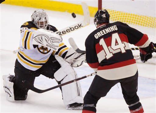 Bruins beat Senators 5-2, take lead in East