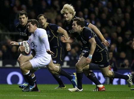 England's Goode runs with the ball during their Six Nations international Rugby Union match against Scotland at the Twickenham Stadium in London