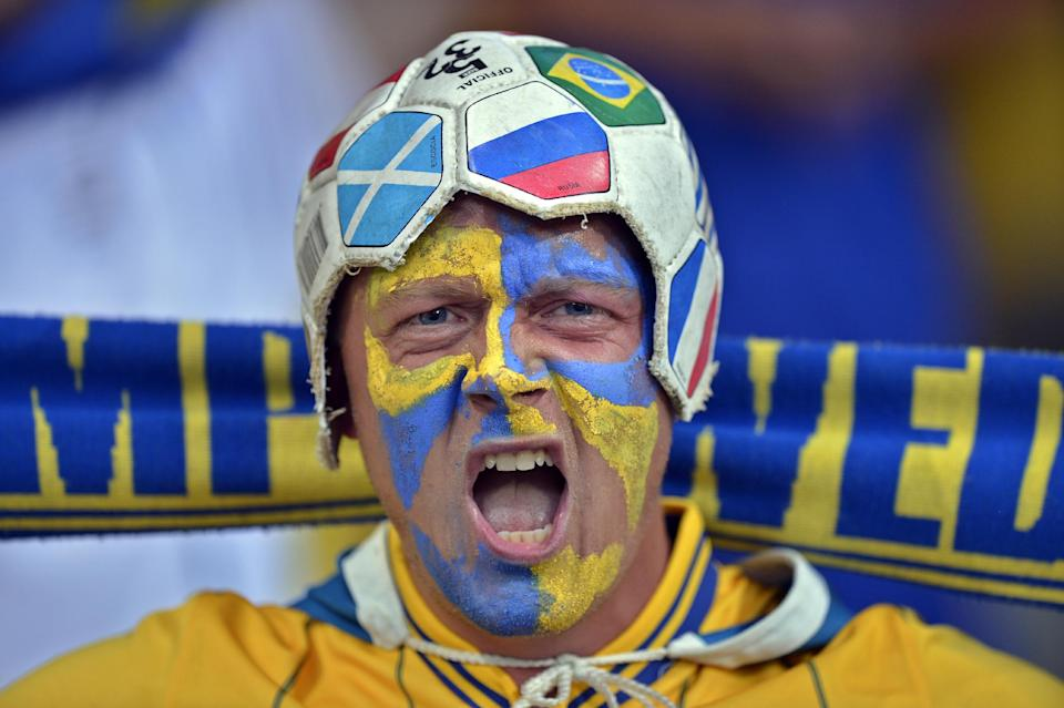 A Swedish fan cheers before the Euro 2012 soccer championship Group D match between Ukraine and Sweden in Kiev, Ukraine, Monday, June 11, 2012. (AP Photo/Martin Meissner)