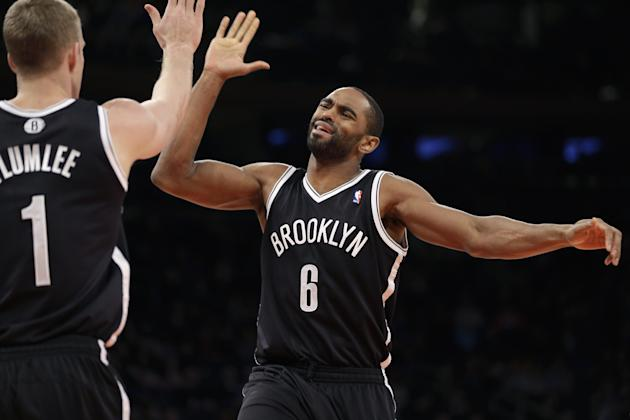 Brooklyn Nets' Alan Anderson, right, celebrates with Mason Plumlee during the second half of the NBA basketball game against the New York Knicks at Madison Square Garden Monday, Jan. 20, 2014, in