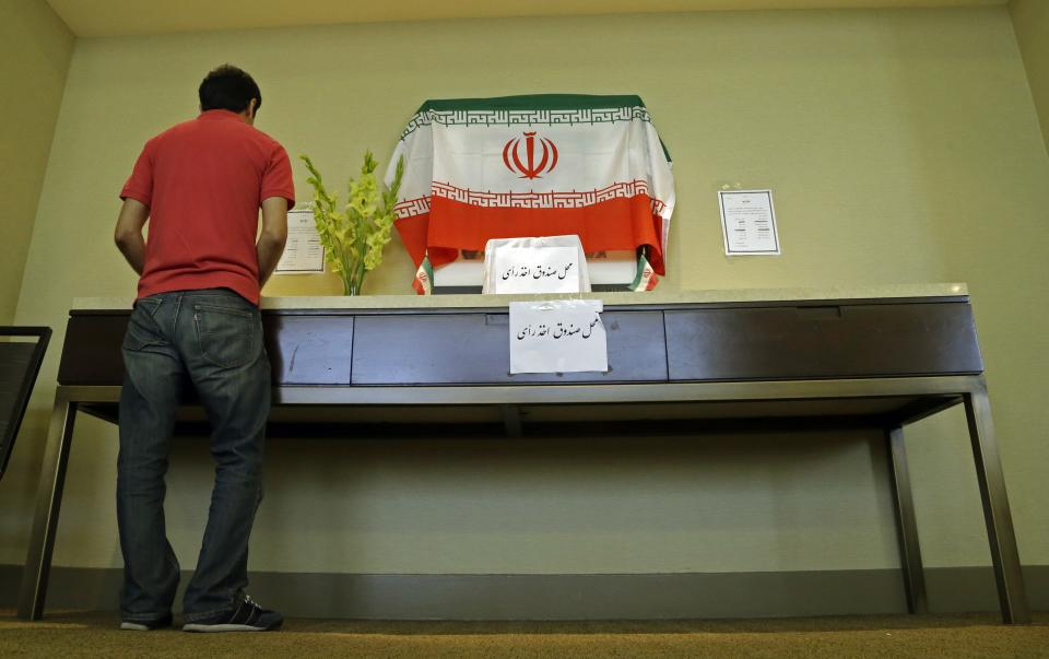 Iranians outside their country of origin cast ballots in Iran's presidential election, in a hotel meeting room in Los Angeles Friday, June 14, 2013. Iranian-Americans and expatriates cast ballots Friday in polling places across the United States, joining their countrymen half a world away in selecting the next Iranian president (AP Photo/Reed Saxon)