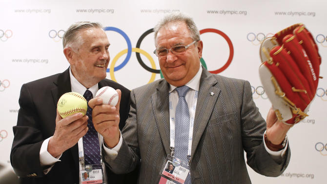 International Baseball Federation President Riccardo Fraccari, right, poses for a photo with Don Porter, president of the International Softball Federation, left, during a news conference in Buenos Aires, Argentina, Friday, Sept. 6, 2013. The International Olympic Committee will vote in Buenos Aires, Sunday, on including one additional sport to the program of the 2020 and 2024 Games. A combined baseball-softball bid is up against wrestling and squash. (AP Photo/Victor R. Caivano)