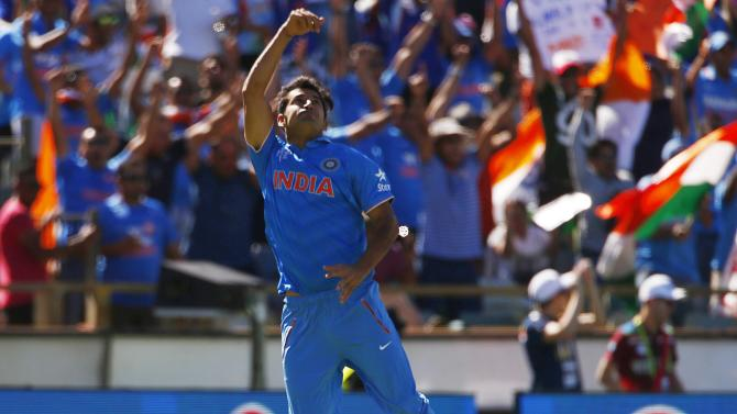 India's Mohit Sharma tosses the ball in the air after catching out West Indies batsman Chris Gayle for 21 runs during their Cricket World Cup match in Perth