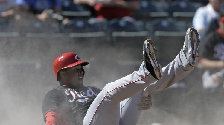 Cincinnati Reds' Chris Nelson scores looks for a call after scoring during the fifth inning of a spring exhibition baseball game against the Texas Rangers Monday, March 10, 2014, in Suprise, Ariz