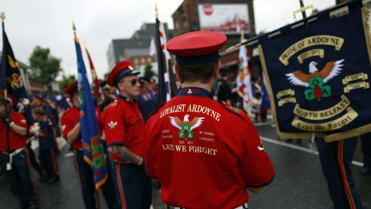 Loyalist band members gather ahead of a parade by members of the Orange Order on Crumlin Road in north Belfast