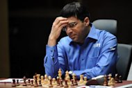 India's Vishwanathan Anand sits motionless during a World chess championship match in Moscow. Title-holder Anand and challenger Boris Gelfand of Israel are slugging out the title fight in Moscow's Tretyakov Gallery, one of the world's greatest collections of Russian art