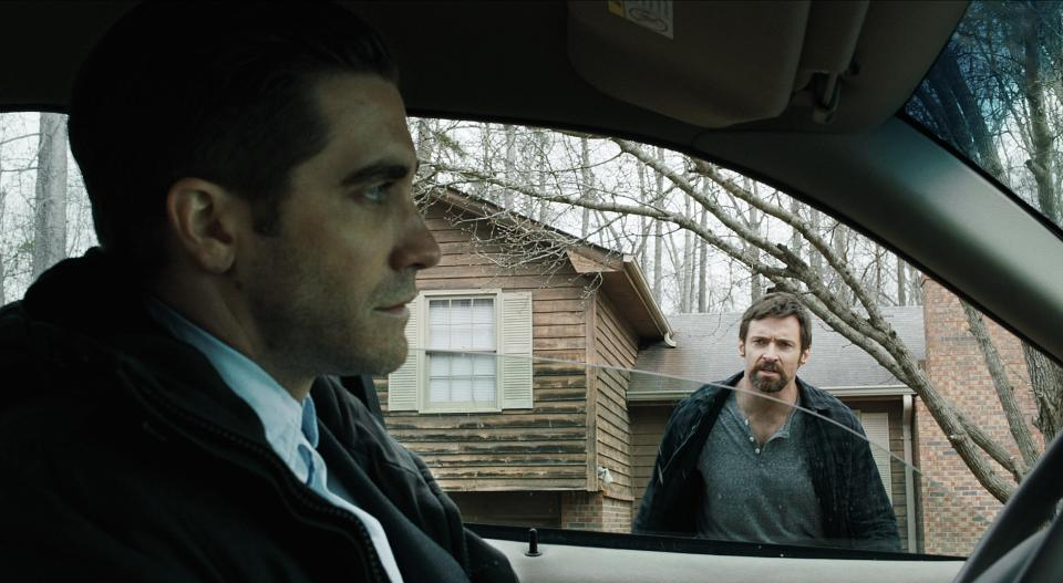 "This publicity image released by Toronto International Film Festival shows, Jake Gyllenhaal, left, and Hugh Jackman in ""Prisoners,"" a film being showcased at the Toronto International Film Festival. (AP Photo/Toronto International Film Festival)"