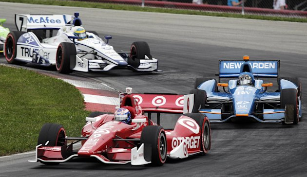 Scott Dixon, of New Zealand, leads a pack of cars during the IndyCar Series Honda Indy 200 auto race at Mid-Ohio Sports Car Course, Sunday, Aug. 5, 2012, in Lexington, Ohio. Dixon won the race. (AP Photo/Jay LaPrete)