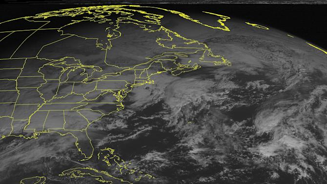 This NOAA satellite image taken Tuesday, December 25, 2012 at 10:45 AM EST shows a low pressure system over the Southern Plains and Lower Mississippi Valley moving into the Southeast with rain and thunderstorms. Snow and snow showers over the Central Plains and Mid Mississippi Valley. Farther north, snow showers are seen over northern New England. (AP PHOTO/WEATHER UNDERGROUND)