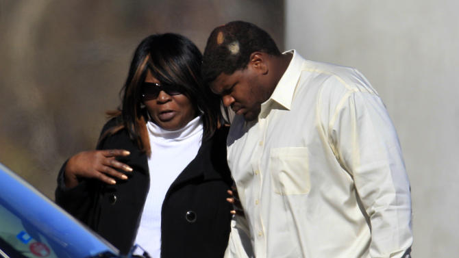 CORRECTS BYLINE TO LM OTERO, NOT TONY GUTIERREZ - Dallas Cowboys football player Josh Brent, right, arrives embracing an unidentified person at a memorial service for teammate Jerry Brown at Oak Cliff Bible Fellowship education center, Tuesday, Dec. 11, 2012, in Dallas. Brown died in a suspected drunken-driving accident on Saturday. Brent was the driver and is charged with intoxication manslaughter. (AP Photo/LM Otero)