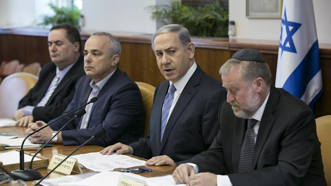 Israel's Prime Minister Netanyahu, Energy and Infrastructure Minister Steinitz and Cabinet Secretary Mandelblit attend the weekly cabinet meeting in Jerusalem