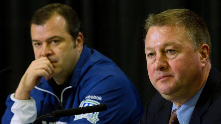 Vancouver Canucks' general manager Mike Gillis, right, and head coach Alain Vigneault look on during a news conference in Vancouver, British Columbia, on Friday June 17, 2011. The Canucks lost to the Boston Bruins in hockey's Stanley Cup final earlier in the week. (AP Photo/The Canadian Press, Darryl Dyck)