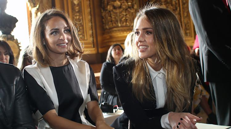 Jessica Alba, left, and Nicole Richie, pose for photographers prior to fashion designer Stella McCartney's Fall/Winter 2013-2014 ready to wear collection, in Paris, Monday, March, 4, 2013. (AP Photo/Thibault Camus)