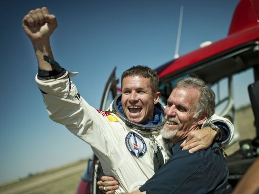Felix Baumgartner of Austria and technical project director Art Thompson of the Unites States celebrate after the jump