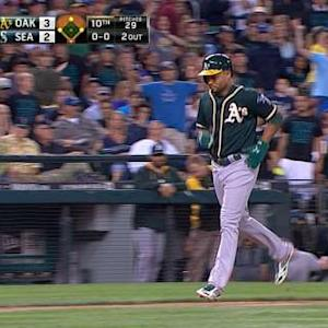 A's take lead on walk