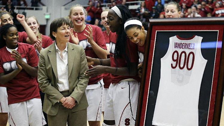 Stanford coach Tara VanDerveer, second from left, is presented a framed jersey in recognition of her 900 career wins after an NCAA college basketball game against Gonzaga, Saturday, Dec. 14, 2013, in Stanford, Calif. (AP Photo/Ben Margot)
