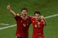 Spanish midfielder Cesc Fabregas celebrates with Spanish midfielder Xabi Alonso after scoring during the Euro 2012 football championships quarter-final match Spain vs France on June 23, 2012 at the Donbass Arena in Donetsk.    AFP PHOTO / JEFF PACHOUD