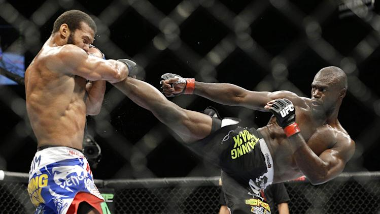 Uriah Hall kicks Thiago Santos during their middleweight mixed martial arts bout at UFC 175 on Saturday, July 5, 2014, in Las Vegas