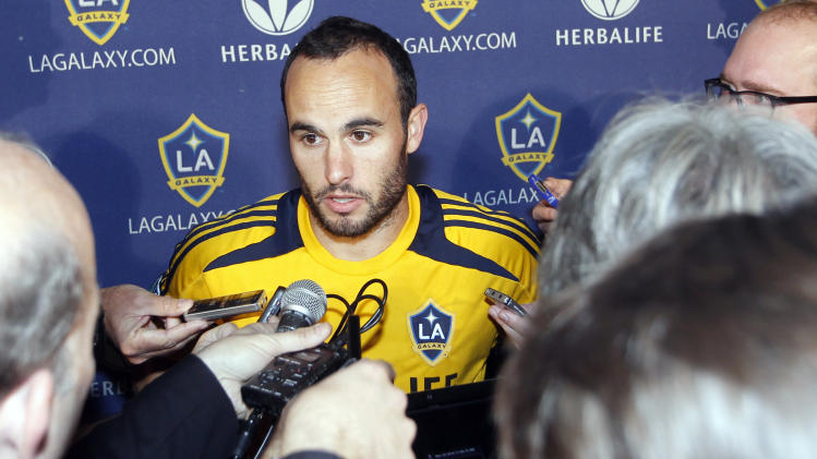Los Angeles Galaxy's Landon Donovan speaks with reporters during a news conference in Carson, Calif., Tuesday, Nov. 20, 2012. Donovan's teammate English soccer star David Beckham will play his final game for the team in the MLS Cup next month. (AP Photo/Alex Gallardo)