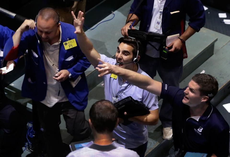 Traders work in the oil options pit at the New York Mercantile Exchange, Wednesday, July 3, 2013. Oil climbed above $101 a barrel as the political crisis in Egypt intensified. (AP Photo/Richard Drew)