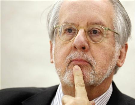 Chair of the Commission of Inquiry on Syria Pinheiro pauses before delivering his report to the Human Rights Council at the United Nations in Geneva