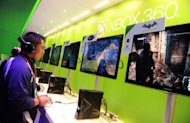 File photo shows Xbox 360 videogame consoles at the International Consumer Electronics Show in Las Vegas in January. Online retail powerhouse Amazon.com has announced a collaboration with Microsoft to begin streaming films and TV shows to Xbox 360 consoles